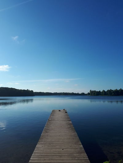 Lake Lake View Lakeview Blue Sky Bluesky Summer2018 Lithuania Lithuania Nature Trakai Trakai, Lithuania Trakai Lakes Blue Jetty Wood - Material Summer Silence Tree Pier Reflection