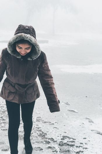 Full length of woman standing in snow