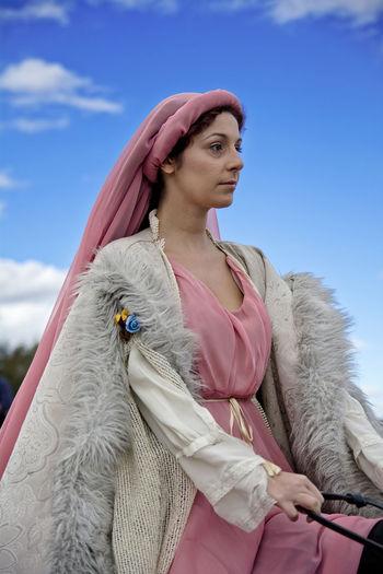 https://open.spotify.com/track/3DtXg352jYP9fUhIqrnFDP Adult Adults Only Cultures Napatu One Person One Woman Only One Young Woman Only Only Women Outdoors Period Costume Portrait Princesa