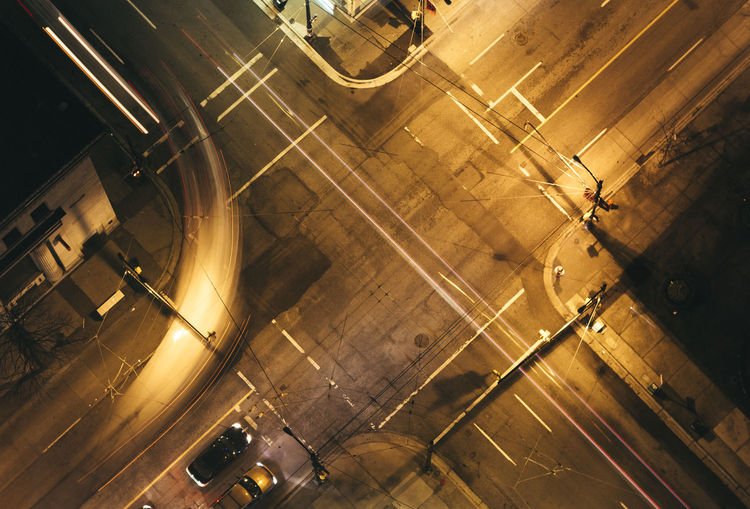 High angle view of illuminated road in city at night