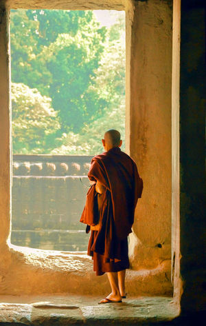 Buddhism Buddhist Temple Full Length Lifestyles Monk  Occupation Real People Rear View Robyn Haworth Spirituality Standing Temple Traditional Clothing