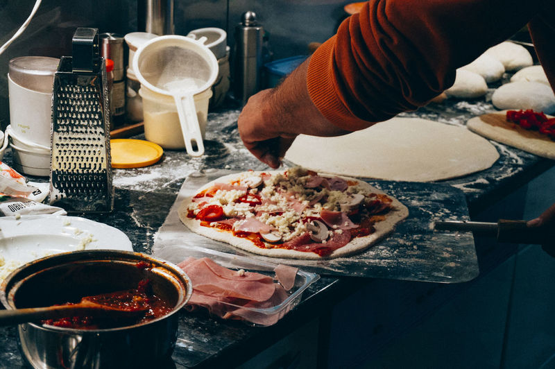 Close-up Cooking Day Food Food And Drink Freshness Holding Human Body Part Human Hand Indoors  Kitchen Kitchen Knife Meat Men One Person People Pizza Plate Preparation  Preparing Food Ready-to-eat Real People