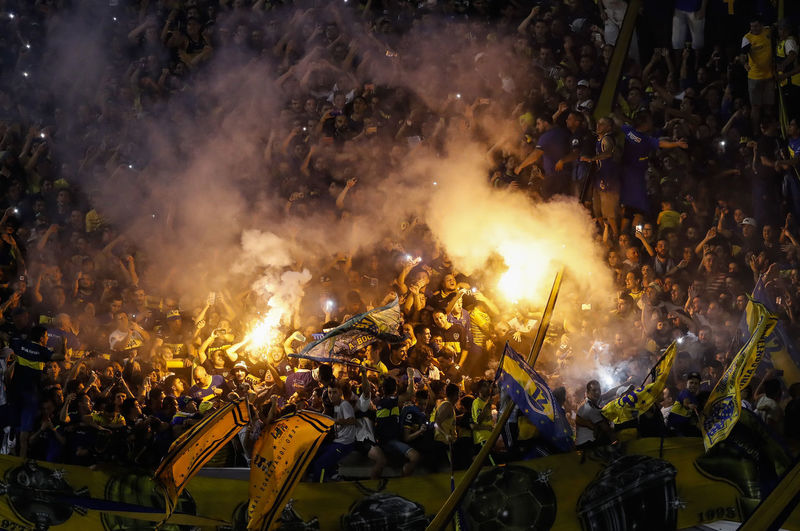 Boca Juniors Stadium Arts Culture And Entertainment Belief Burning Crowd Enjoyment Festival Group Of People Heat - Temperature Large Group Of People Leisure Activity Lifestyles Men Motion Nature Night Outdoors Real People Religion Smoke - Physical Structure Togetherness