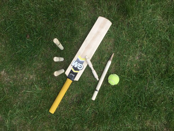 Children's cricket set on grass Grass No People Outdoors Cricket Bat High Angle View