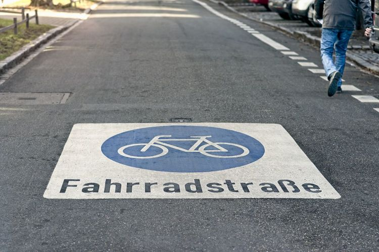 Fahrradstraße in Ulm, Baden Würtemberg. Casual Clothing Jeans Pentax Focus On Foreground Street Direction Day Marking Outdoors Fahrradstrasse Radweg Fahrrad Cycle Path Bike Low Section Symbol City Road Marking Human Body Part Transportation One Person Text Road Sign Road Sign
