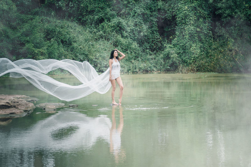 Trees Adult Arms Raised Beautiful Woman Beauty In Nature Day Fashion Forest Trees Full Length Human Arm Lake Nature One Person Outdoors Plant Real People Reflection Standing Tree Veil Water Waterfront Women Young Adult Young Women