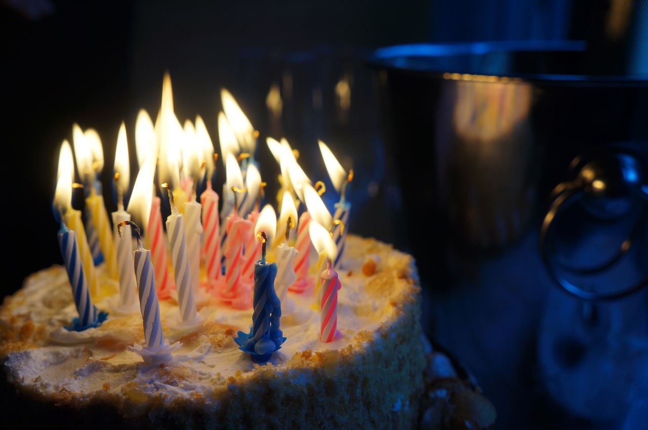 flame, candle, burning, food and drink, birthday candles, birthday cake, celebration, heat - temperature, cake, indoors, glowing, birthday, sweet food, indulgence, illuminated, temptation, close-up, food, focus on foreground, no people, freshness, table, life events, day, ready-to-eat