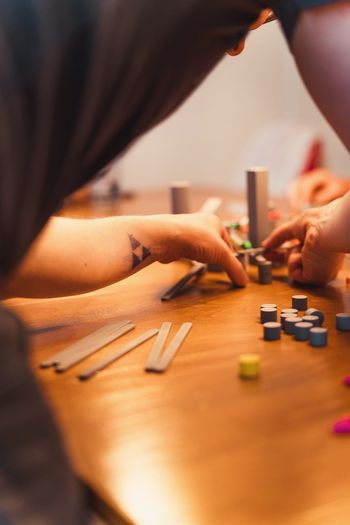 Human Body Part Human Hand Hand One Person Indoors  Table Close-up Art And Craft Leisure Activity Occupation Unrecognizable Person Equipment Human Limb Holding Home Interior Body Part Selective Focus Men Adult Finger