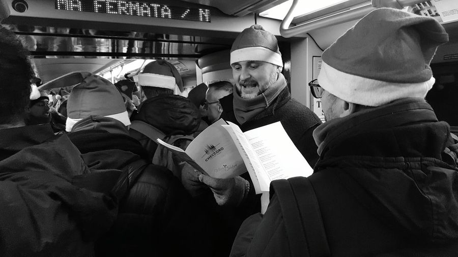 Christmastime: a Chorus in Underground Santaklaus Christmas Time Men Adults Only Adult People Streetphotography Street Photography Streetphoto_bw Singing City Life Blackandwhite Black And White Black & White Streetphotography_bw