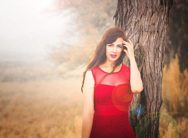 Beauty Portrait Red Fashion Beautiful People Young Adult Nature One Person Beauty In Nature Sunlight Long Hair Tree Standing Human Body Part Arts Culture And Entertainment People Women Fashion Model Outdoors Females Real People Silhouette Geogeous Love