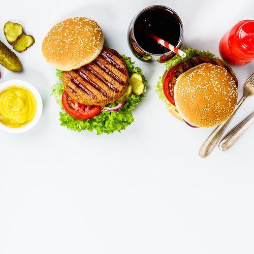 Close-up of burgers on serving board