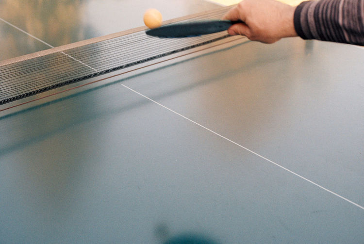 Cropped hand playing table tennis