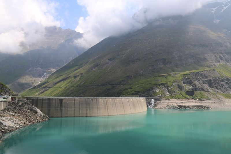 Scenic view of dam and mountains