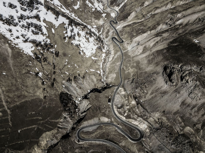 Aerial image of the hairpin bends leading to Colle della Maddalena, on the border between Italy and France (Piedmont, Italy) Mountain No People Nature Textured  Environment Outdoors High Angle View Solid Geology Mineral Transportation Aerial View Day Pattern Dronephotography Drone Photography Drone  Droneshot Aerial Photography Aerial Shot Valle Stura Piemonte Italia Italy Cuneo France Border Road Cars Rock - Object Rock Formation Rocky Mountains Snow Springtime Sky_collection Argentera Colle Della Maddalena Colle Della Maddalena , Col De Larche Brown Color Alps Italy Alps Alpine Nature_collection Naturelovers Nature EyeEm Best Shots EyeEm Nature Lover EyeEm Gallery EyeEm Selects Luca Prestia