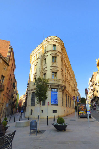 Archeology Museum Of Reus Architecture Blue Building Building Exterior Built Structure City Clear Sky Copy Space Day History Incidental People Nature Outdoors Potted Plant Residential District Sky Street Sunlight The Past