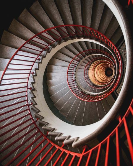 Ljubljana spirals Spiral Pattern Staircase Spiral Staircase Steps And Staircases Indoors  Railing Architecture No People Design Built Structure Circle Directly Above Metal Shape Red Diminishing Perspective High Angle View Full Frame Swirl The Architect - 2018 EyeEm Awards