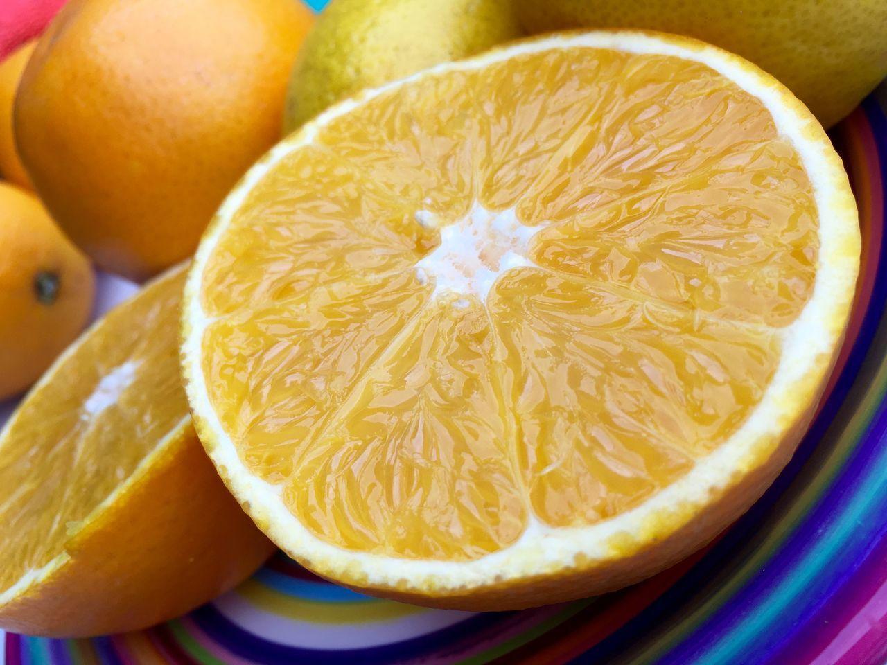 Tilt Image Of Halved Oranges In Plate