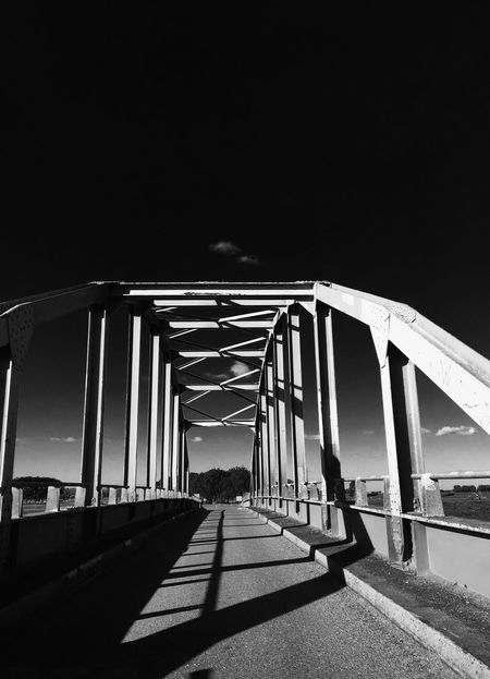 Monochrome Photography Connection Architecture Built Structure Shadow The Way Forward Engineering Water Bridge Sunlight Clear Sky Railing Sky Day Footbridge Long Modern Outdoors Diminishing Perspective Elevated Walkway