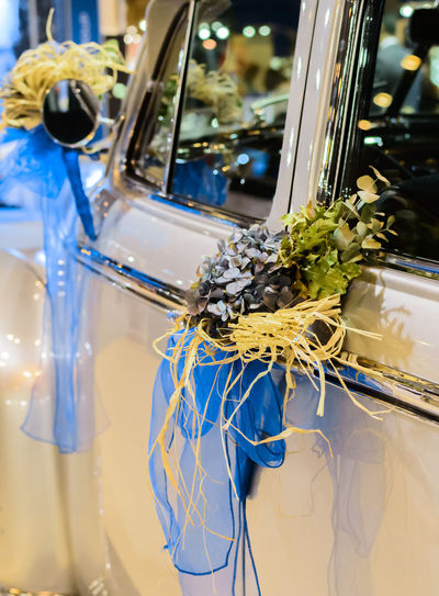 Vertical view of bridal bouquet of flowers attached to the side of a white car. Beautiful Bouquet Bridal Bridal Bouquet Close-up Floral Flower Marital Marriage  Matrimonial Nuptial Wedding