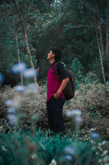 Man Looking Away In Forest