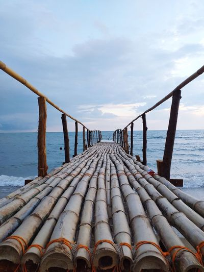 View of wooden structure on beach against sky