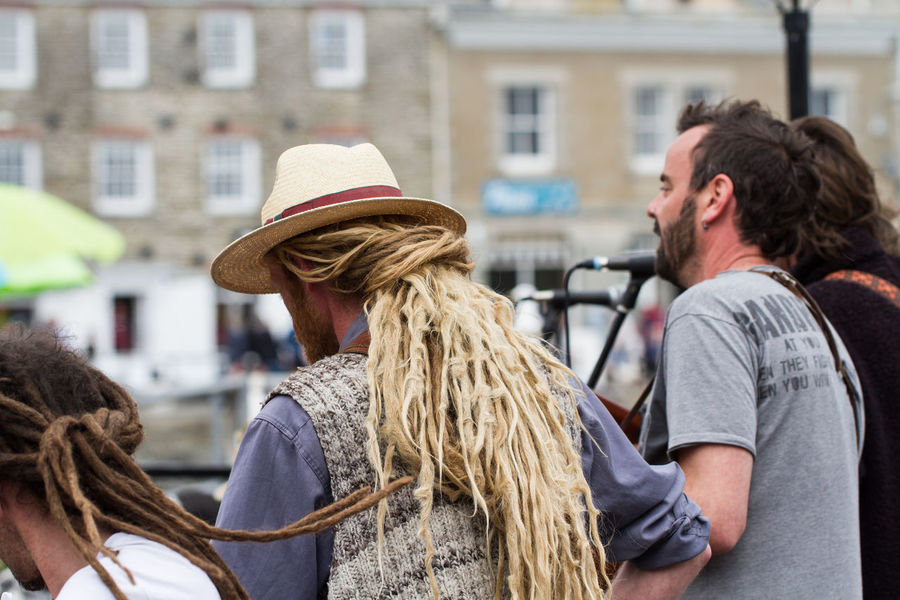 Members of the busking group 'Phat Bollard' singing their political songs on the streets of Padstow in Cornwall, UK. Activists Band Britain Buskers Busking Cornwall Day Dreadlocks Festival Festival Season Group Hippies Instruments Music Musicians Outdoors Padstow People Phat Bollard Political Political Songs Sing Singing Singing My Heart Out Uk