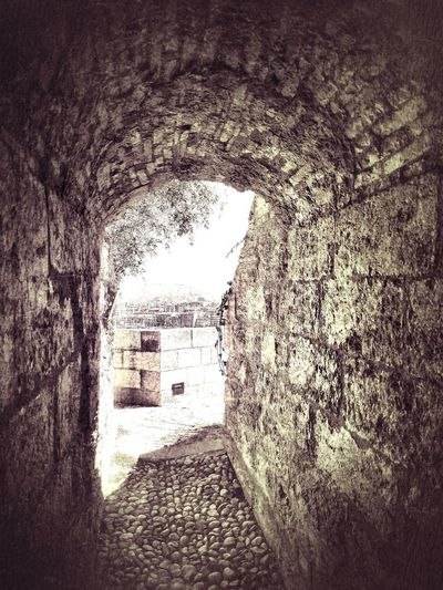 Archway of old building in tunnel