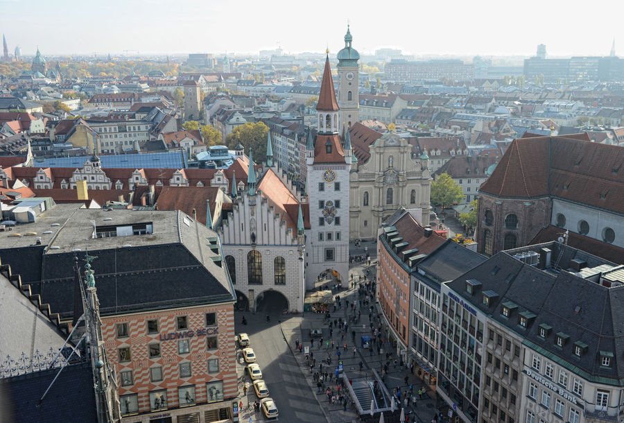 View over the Marienplatz from top of Town hall. In background old town hall and Heiliggeistkirche church. People walking across the place. Architecture Built Structure City City Life City Life Cityscape Cityscape Day Elevated View Heiliggeistkirche Marienplatz Munich Munich, Germany München München Munich München,Germany Outdoors Residential Building Tourism Town Travel Destinations