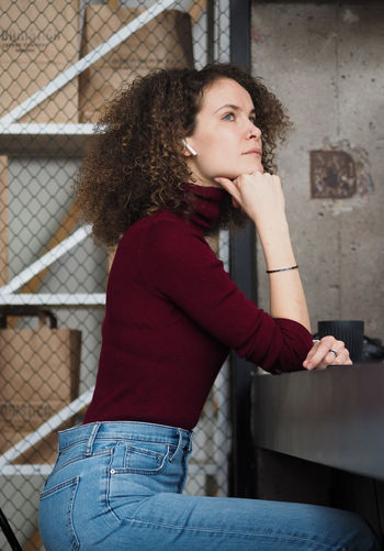 Portrait of beautiful young woman looking away