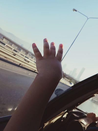 EyeEm New Here Baby Fingers Bluesky Vastness Car Wind Sunlight
