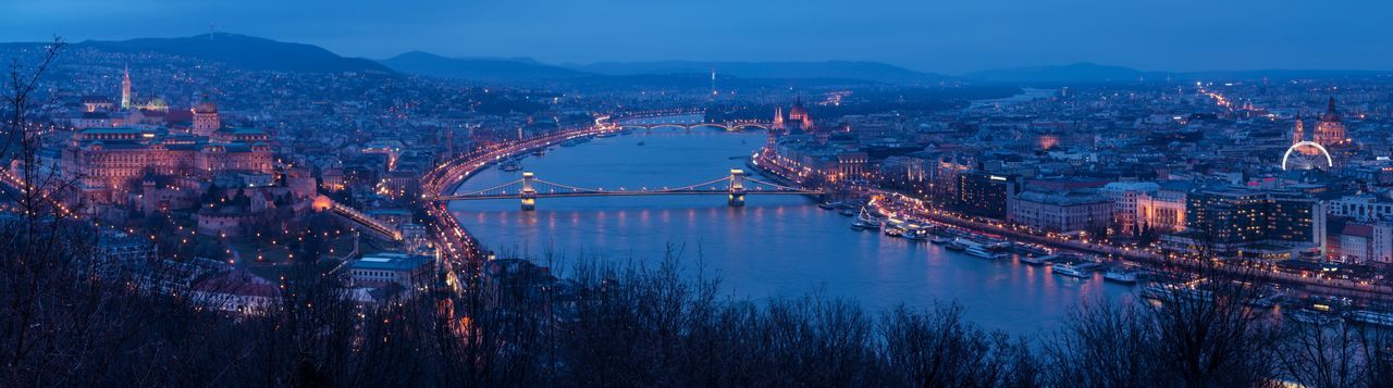 Aerial view of bridge over river at dusk