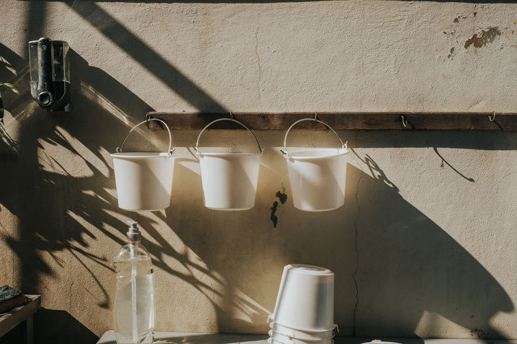 Buckets hanging against wall