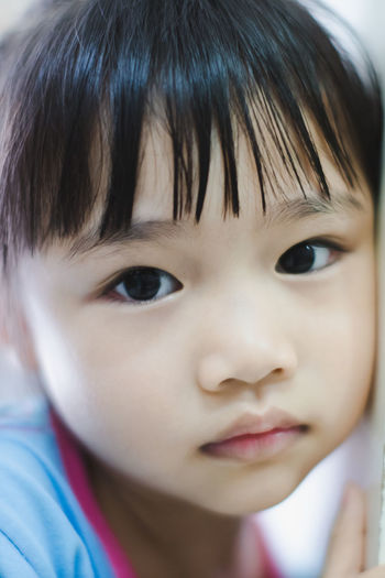 Bangs Black Hair Body Part Child Childhood Close-up Cute Front View Girls Hair Hairstyle Headshot Human Face Innocence Men One Person Portrait Real People