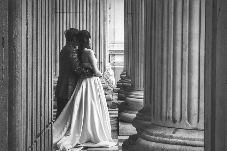 Couple standing in corridor