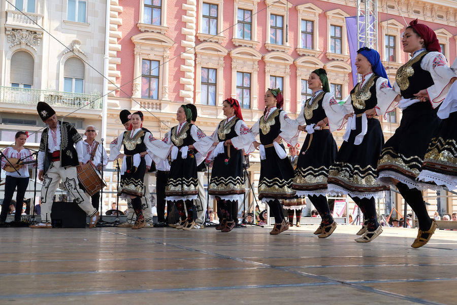 Members of folk group Bistrica from Bistrica, Bulgaria during the 50th International Folklore Festival in center of Zagreb, Croatia on July 21, 2016 Bistrica Bulgaria Celebration Celebration Costume Croatia Culture Dance Entertainment Event Festival Folk Folklore Heritage Historic Historical Music Participant Perform Style Tradition Zagreb