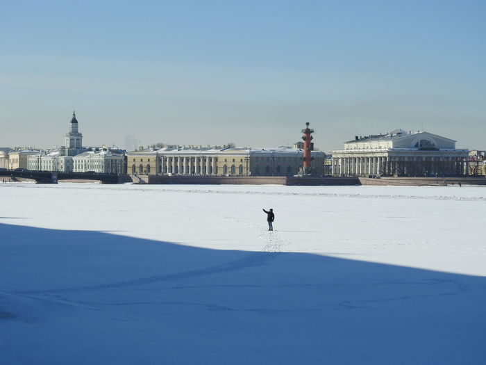 View of buildings on snow covered landscape