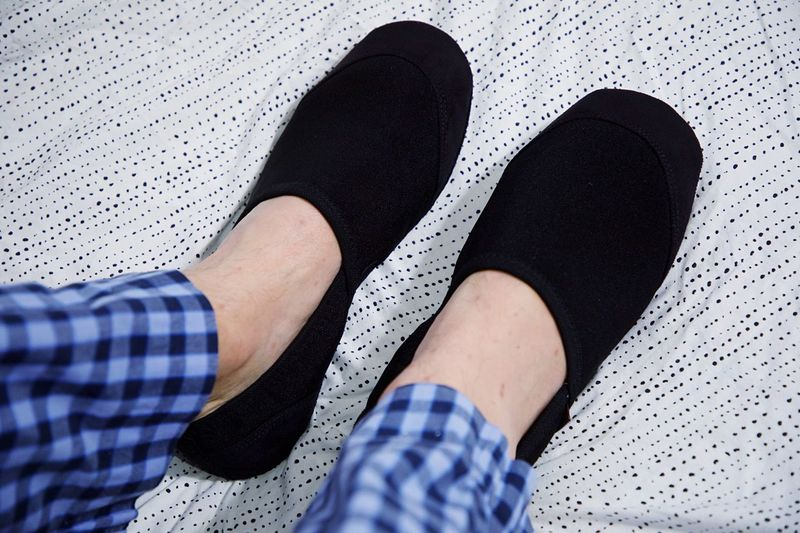 Slippers Low Section Human Leg Human Body Part Body Part Shoe Real People High Angle View One Person Personal Perspective Lifestyles Limb Human Foot Human Limb Sock Leisure Activity Standing Directly Above Adult Unrecognizable Person