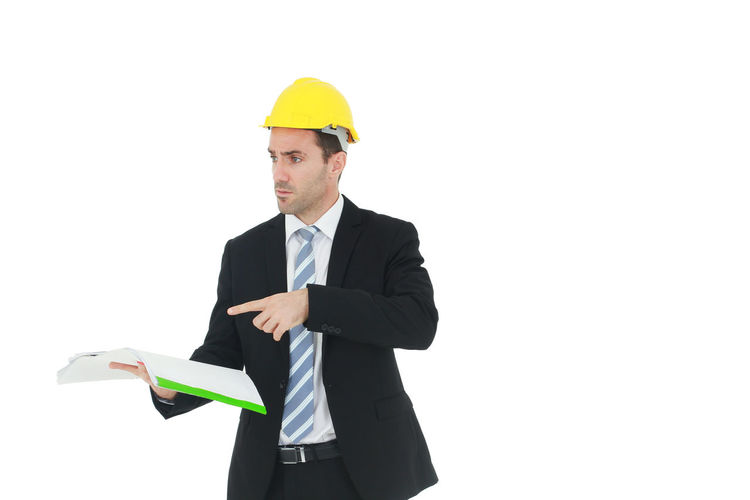 Man wearing hat standing against white background