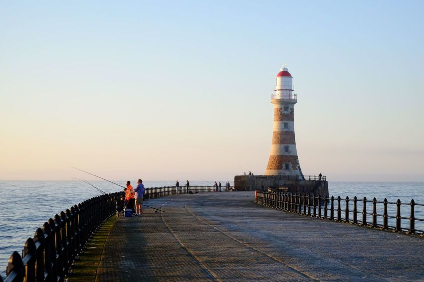 Early morning fishing at Roker Lighthouse Morning Light Sunrise Sky Sea Water Built Structure Tower Architecture Clear Sky Nature Direction Group Of People Real People Building Exterior Lighthouse Horizon