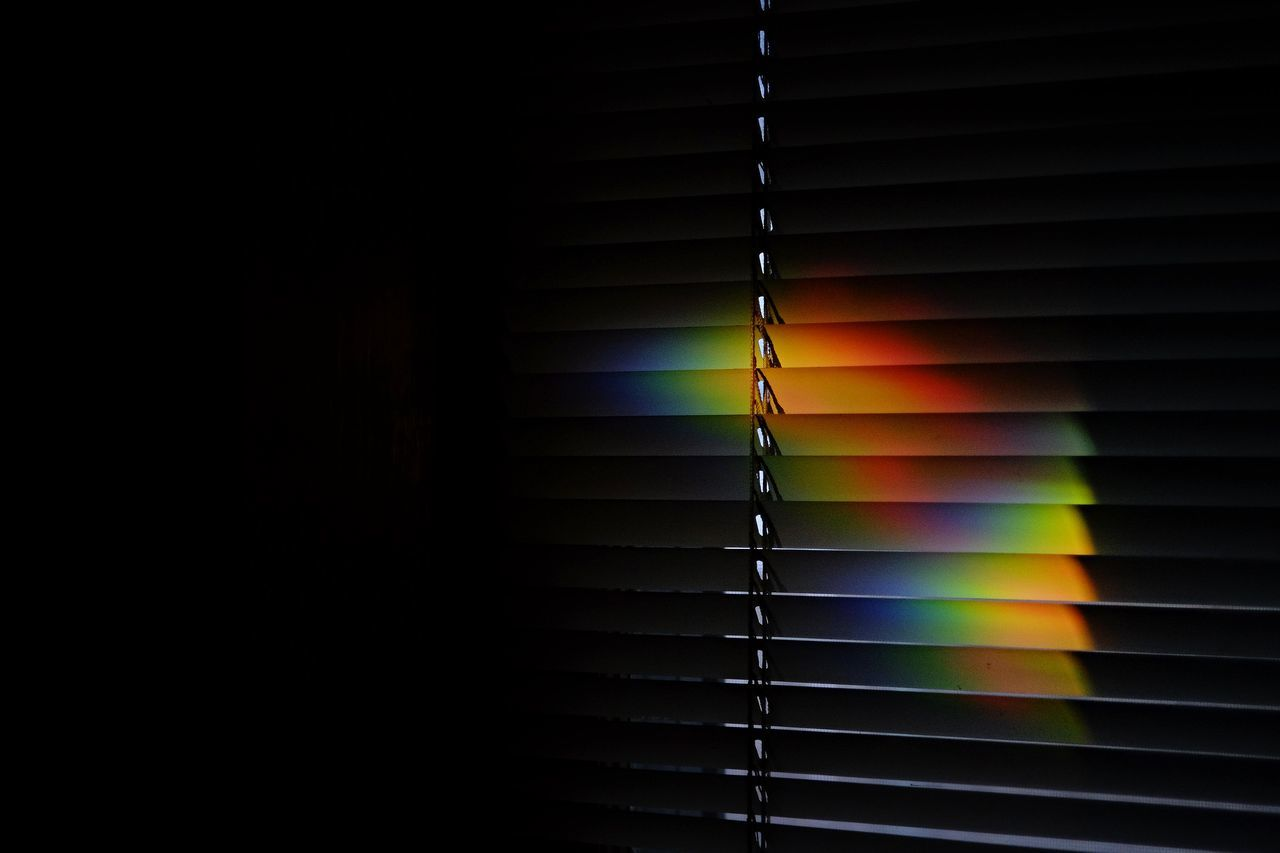 Close-up of blinds in the dark