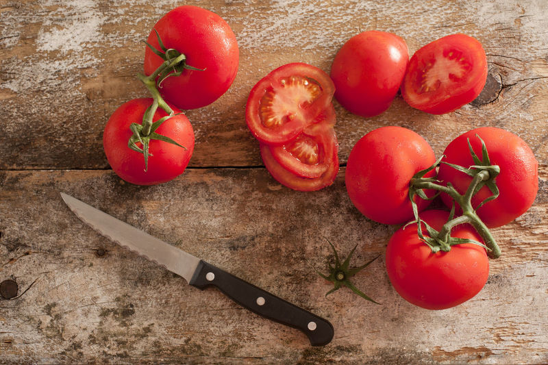 High angle view of chopped tomatoes on cutting board