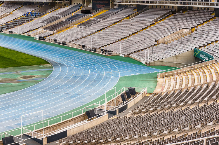 BARCELONA - AUGUST 11: Interior view of the Olympic stadium Lluis Companys, in the Olympic Ring complex located on Montjuic hill, Barcelona, Catalonia, Spain, as seen on August 11, 2017 Built Structure Stadium Architecture No People Sport Day High Angle View Outdoors Absence Curve City Travel Destinations Bleachers Building Exterior Seat Pattern Empty Sports Track Aerial View