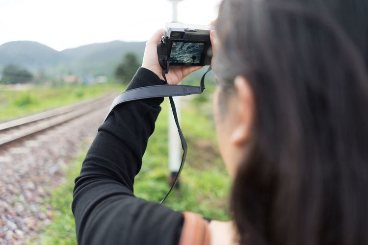EyeEmNewHere Photography Themes Photographing Technology Holding Rear View One Person Camera - Photographic Equipment Women Close-up Portable Information Device Human Hand Digital Viewfinder Human Body Part Take Photos Lieblingsteil Women Around The World Live For The Story Second Acts Be. Ready. Go Higher
