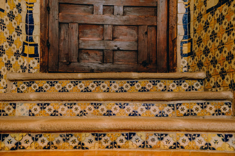 Escaleras de talavera Wood - Material Architecture Pattern No People Yellow Built Structure Day Staircase Old Building Exterior Door Building History Closed Entrance Outdoors House The Past Weathered Floral Pattern
