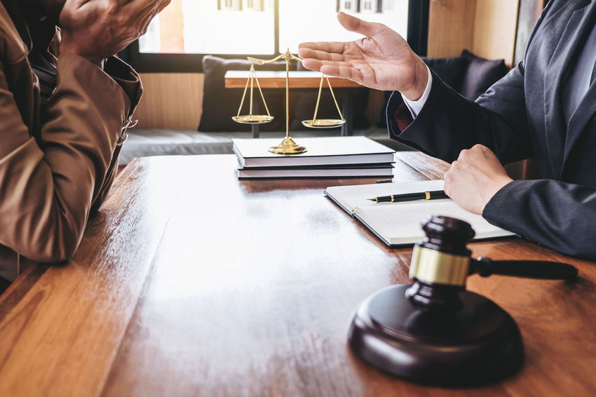 Lawyer Adult Balance Barrister Business Business Person Businessman Counselor Customer  Fairness Gavel Hand Holding Human Body Part Human Hand Indoors  Judge Judgement Legal Legislation Leisure Activity Men People Two People Verdict
