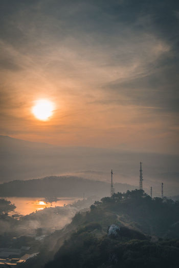 Sunset view from Bandung. Air Pollution Architecture Beauty In Nature Built Structure Cloud - Sky Communication Global Communications Lake Landscape Mountain Nature No People Orange Color Outdoors Pollution Portrait Scenics - Nature Silhouette Sky Sun Sunlight Sunset Technology Tower Tranquility EyeEmNewHere
