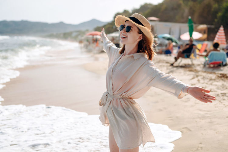 Woman standing at beach