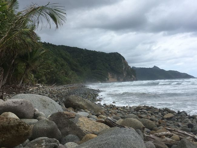 Dominica Beach Beauty In Nature Cloud - Sky Day Mountain Nature No People Outdoors Pebble Pebble Beach Rock - Object Scenics Sea Sky Water