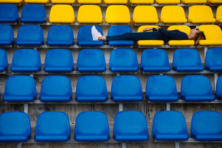 Absence Abundance Arrangement Backgrounds Bleachers Blue Chair Empty Full Frame In A Row Indoors  Large Group Of Objects No People Order Plastic Repetition Seat Side By Side Sport Stadium The Traveler - 2018 EyeEm Awards The Fashion Photographer - 2018 EyeEm Awards