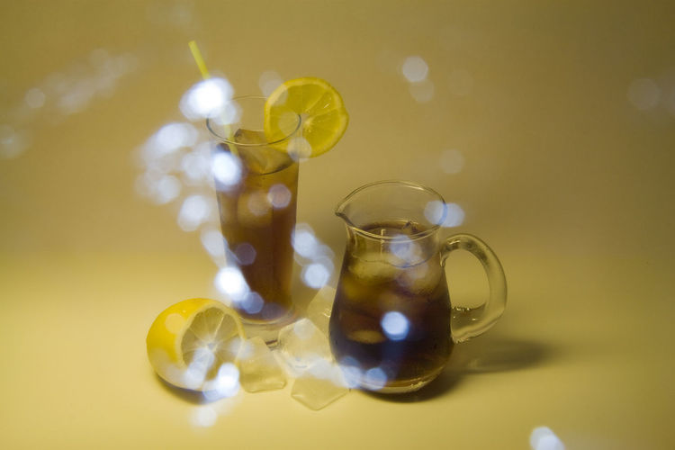 Summer refreshment Bokeh Close-up Day Drink Drinking Glass Drinking Straw Drinks! Food Food And Drink Fresh Freshness Ice Ice Cube Ice Cubes Ice Tea Indoors  Lemon No People Refreshment Still Life Summer Table Tea Yellow